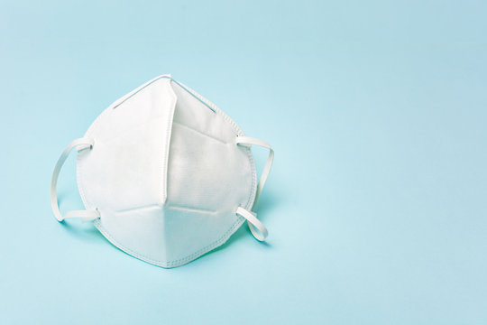 White medical face mask. Concept of coronavirus quarantine and ultra-fine microdust. Isolated of white background. Top view.