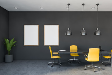 Yellow and gray conference room with poster