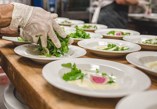 Cropped Image Of Chef Making Salad In Kitchen