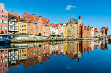 Amazing view of Gdansk old town over Motlawa river with beautiful reflection in the water. Gdansk,...
