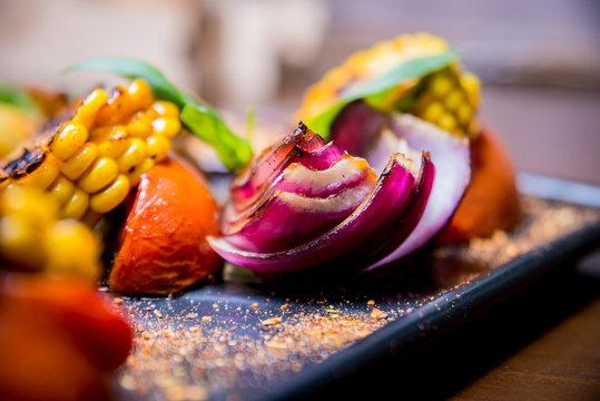 Tasty grilled vegetables on big plate. Healthy food. Restaurant.
