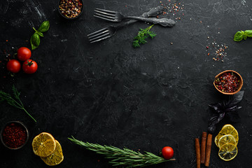Wall Mural - Black Stone Food Background. Cooking Ingredients. Top view. Free space for your text.