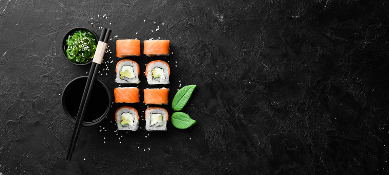 Philadelphia sushi roll with salmon and avocado. Japanese Traditional Cuisine. Top view. Rustic style.