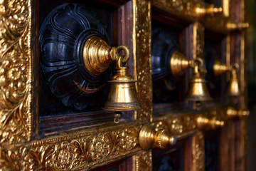 Golden bells on the door of a Hindu temple.