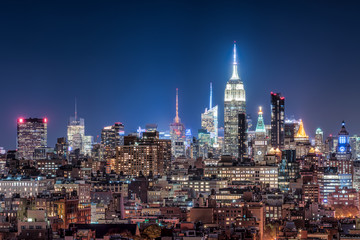 Midtown Manhattan skyline with Empire State Building at night
