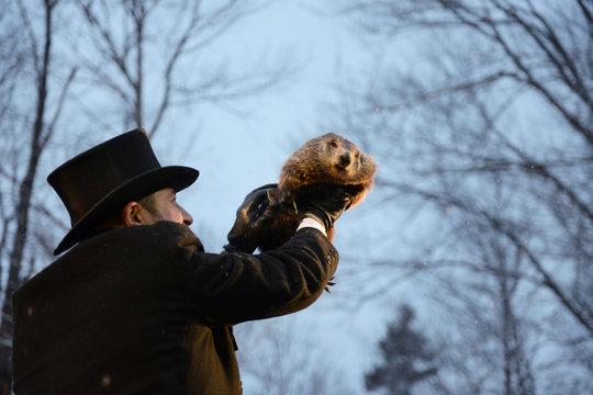 Punxsutawney Phil's co-handler AJ Dereume holds the famous groundhog on the 134th Groundhog Day at Gobblers Knob in Punxsutawney