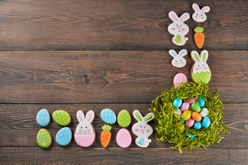 Easter ginger cookies and eggs in nest.