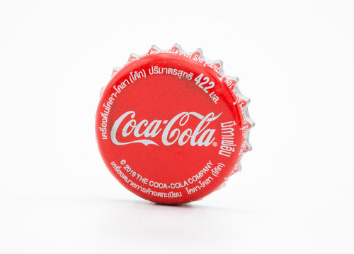 BANGKOK, THAILAND - January 3, 2020: Coca-Cola logo printed on aluminium lid with white background. Coca-Cola is a carbonated soft drink sold in stores and restaurants throughout the world.