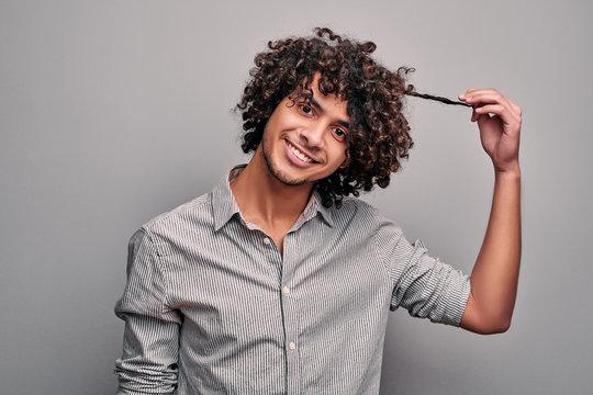 Arabian man shows his healthy beautiful curly hair