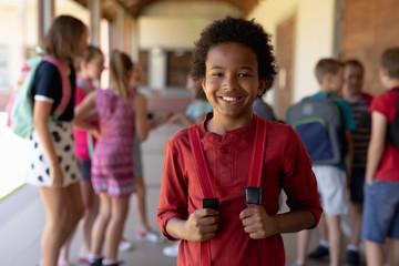 Schoolboy standing in the schoolyard at elementary school