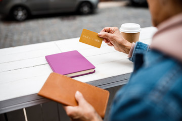 Woman using cashless payment in cafe stock photo