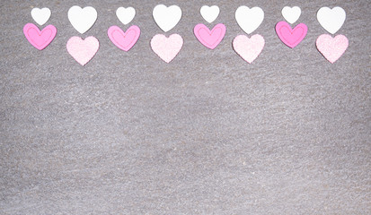 gray granite background with pink and white hearts for valentines day. Valentine's day and love concept