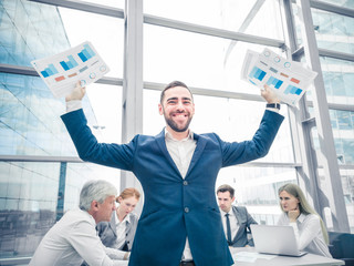 Young businessman with raised arms