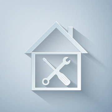 Paper cut House or home with screwdriver and wrench icon isolated on grey background. Adjusting, service, setting, maintenance, repair, fixing. Paper art style. Vector Illustration
