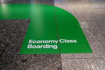Economy class boarding green painted lane at airport boarding area in terminal