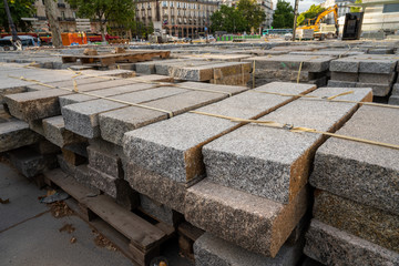 Pile of marble blocks in on pallets in outdoor construction area