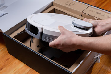 New robotic vacuum cleaner in a cardboard box