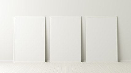 Three vertical posters. frame mock up standing on white floor next to white wall. Clipping path around posters. 3d illustration