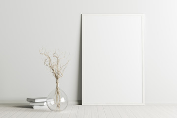Blank vertical poster frame mock up standing on white floor next to white wall with vase and books. Clipping path around poster. 3d illustration