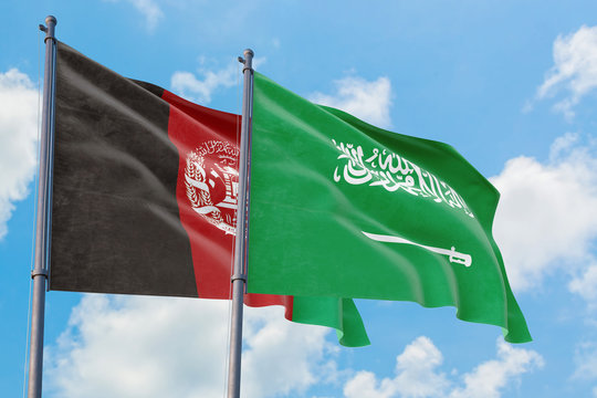 Saudi Arabia and Afghanistan flags waving in the wind against white cloudy blue sky together. Diplomacy concept, international relations.