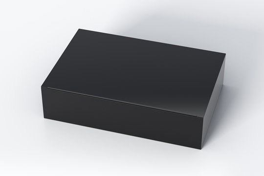 Blank black wide flat box with closed hinged flap lid on white background. Clipping path around box mock up. 3d illustration