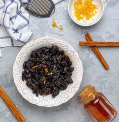 Raisins and orange zest soaked in rum.