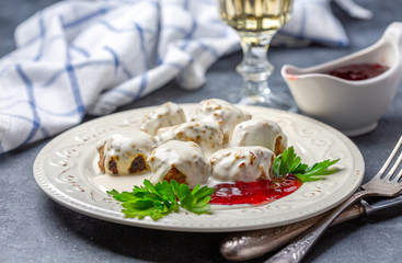 Swedish meatballs are served with cream sauce and lingonberry.