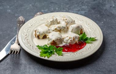 Homemade meatballs in cream sauce with cranberries.