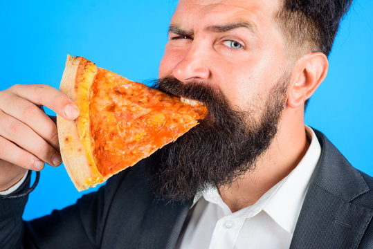 Pizzeria. Bearded man hold slice of pizza. Fastfood. Bearded man eating pizza. Man eat fresh pizza slice. Delicious fast food. Italian cuisine. Tasty pizza at restaurant. Lunch or dinner. Margarita.