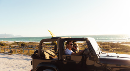 Couple in a car at the beach