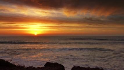 Fototapete - Big waves of Atlantic ocean and sunset sun, 4k