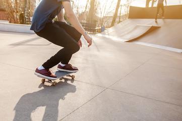 Unrecognizable skateboarder on his board. Photo was taken in backlight