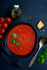 Gazpacho - traditional spanish cold tomato soup. Top view with copy space.