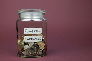 jar with money used for funeral expenses