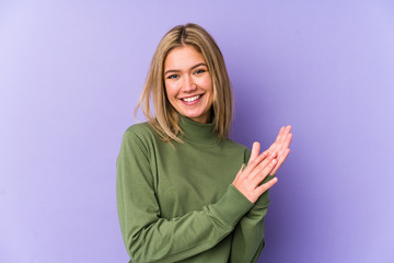 Young blonde caucasian woman isolated feeling energetic and comfortable, rubbing hands confident.