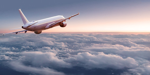 Zelfklevend Fotobehang Vliegtuig Commercial airplane jetliner flying above dramatic clouds in beautiful light. Travel concept.