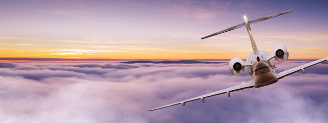 Small private jetplane flying above beautiful clouds. Travel and transportation concept. Fotomurales