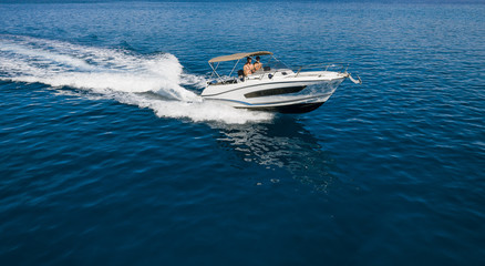 Speed boat in mediterranean sea, aerial view Wall mural