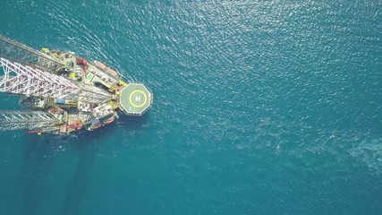Wall Mural - Aerial view of the jack up rig being towed to the offshore location