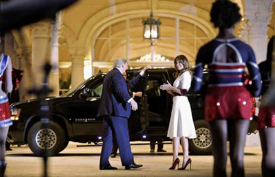 U.S. President Donald Trump leave the Florida Atlantic University Marching Band performance in Florida