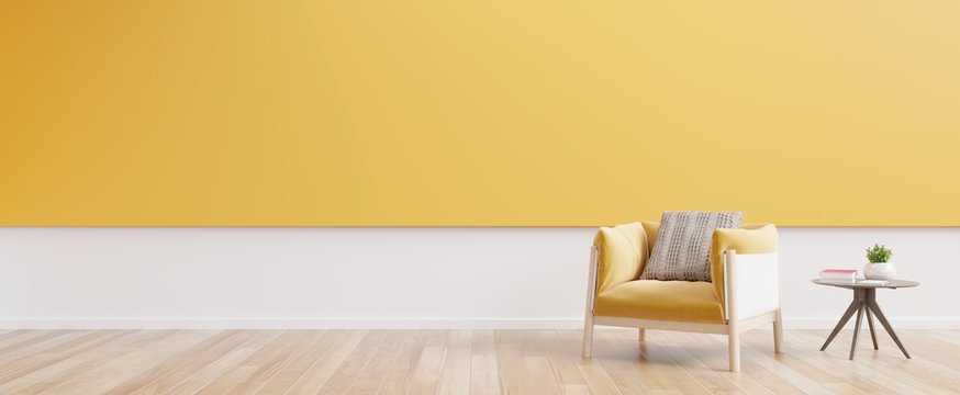 Living room interior with yellow fabric armchair,book and plants on empty yellow wall background.