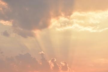 golden light rays of sunset sky background