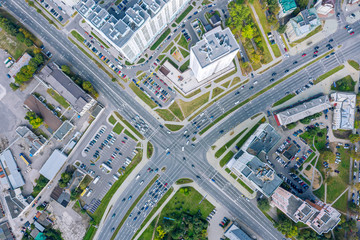 Foto auf Leinwand Dunkelgrau aerial top view of urban road intersection on a summer day. car traffic on city crossroad