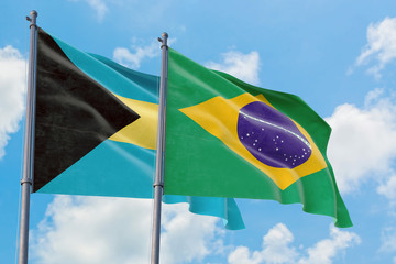 Foto op Canvas Brazilië Brazil and Bahamas flags waving in the wind against white cloudy blue sky together. Diplomacy concept, international relations.