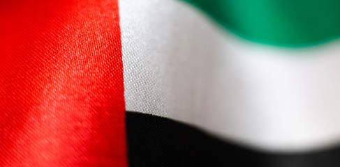 Macro close up of UAE flag cloth material texture