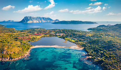 Photo sur cadre textile Europe Méditérranéenne View from flying drone. Breathtaking spring scene of Salina Bamba beach with Tavolara mountain on background. Captivating morning view of Sardinia island, Italy, Europe. .
