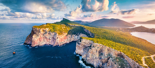 Foto auf Gartenposter Blau Jeans Panotamic view from flying drone. Great sunrise on Caccia cape. Breathtaking spring scene of Sardinia island, Italy, Europe. Fantastic morning seascape of Mediterranean sea.