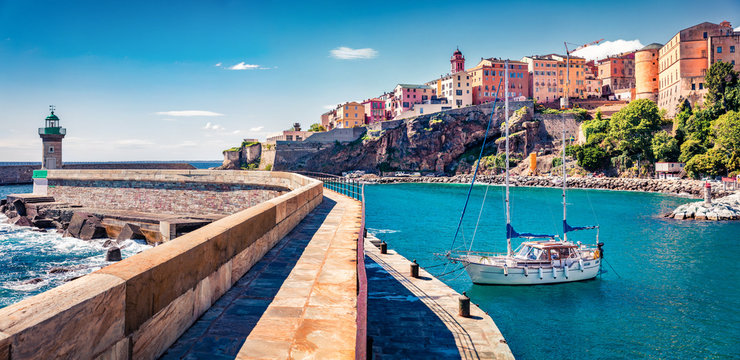 Panoramic spring cityscape of Bastia port. Sunny morning view of Corsica island, France, Europe. Attractive Mediterranean seascape with yacht and lighthouse. Traveling concept background..