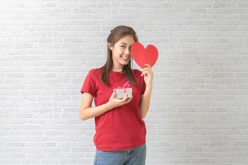 Young woman catching Valentine Hearts and gift box. Love concept. Valentines day.