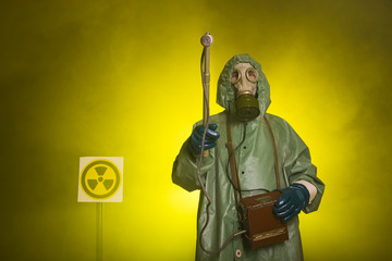 Radiation and danger concept - Man in old protective hazmat suit Wall mural